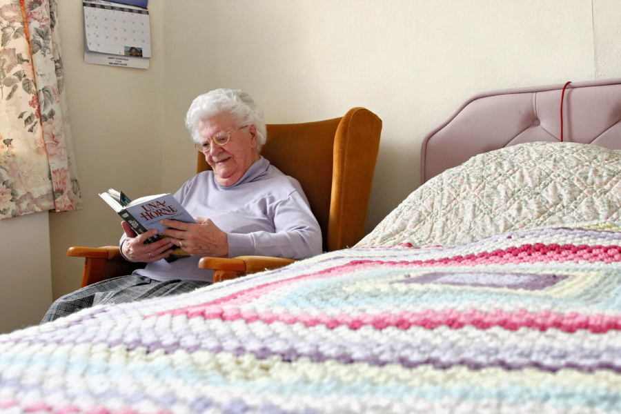 Walmer House Resident Reading Book